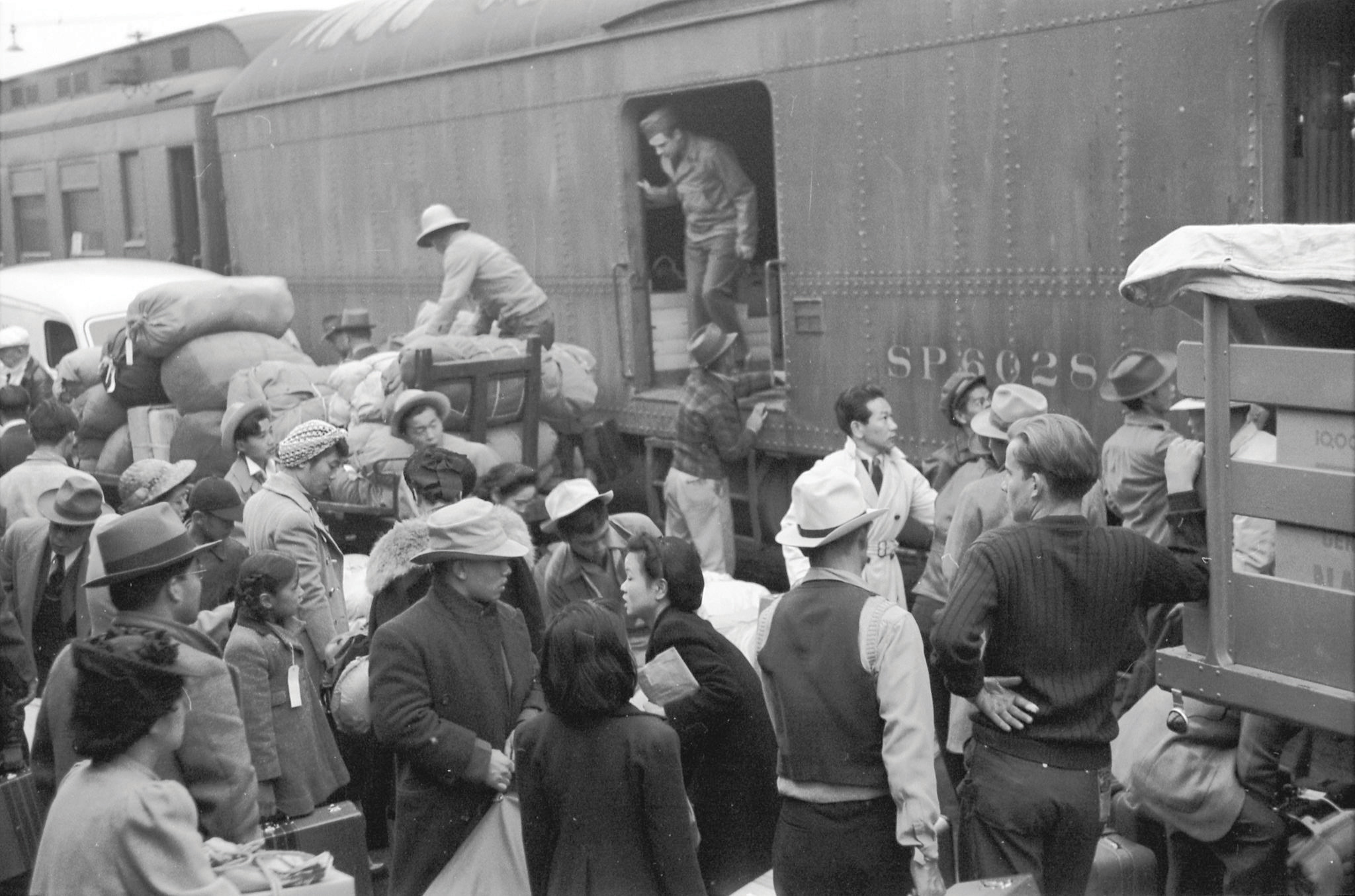 Japanese Americans being shipped to internment camps during World War II