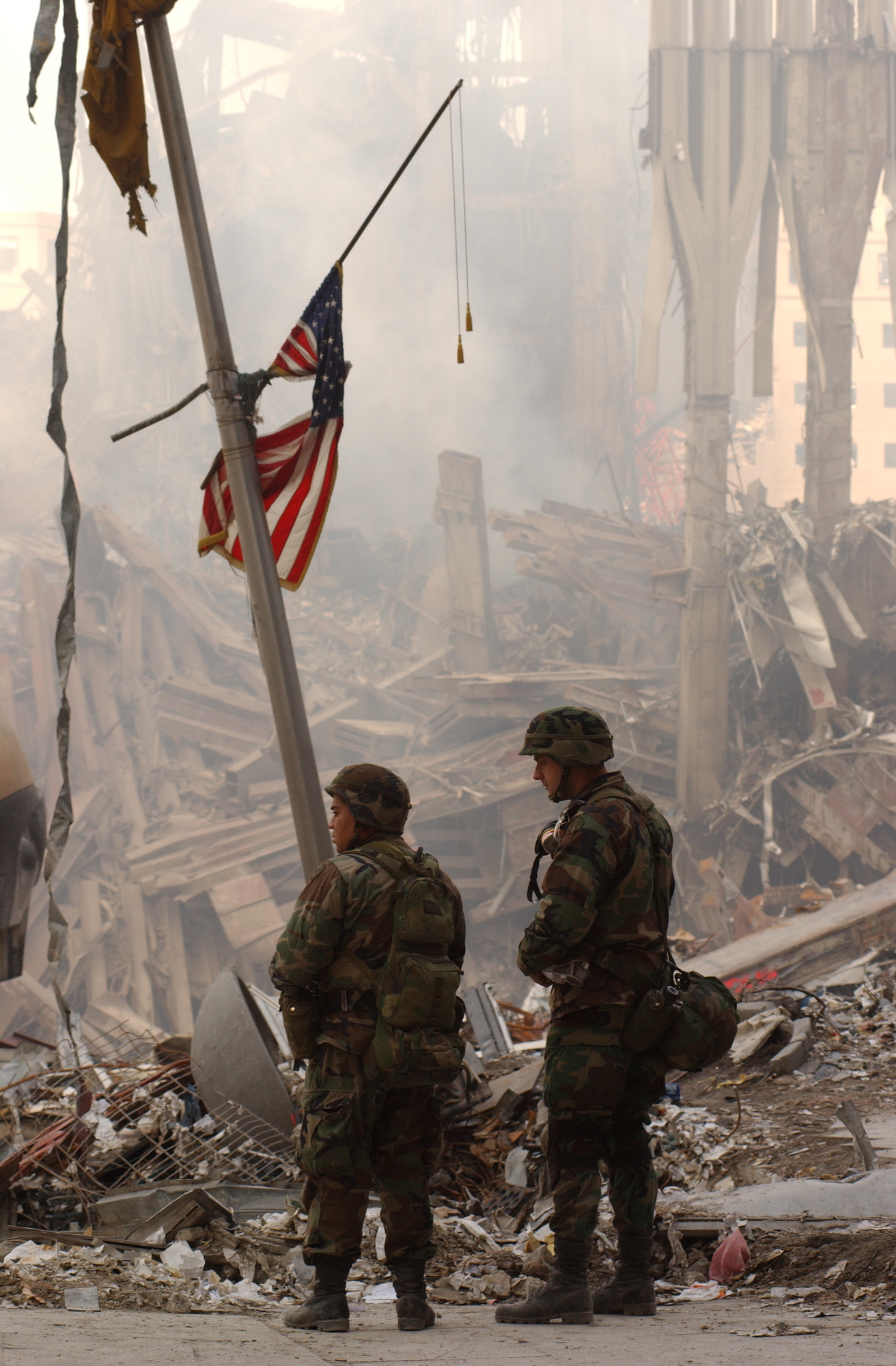 soldiers standing by a fallen flag
