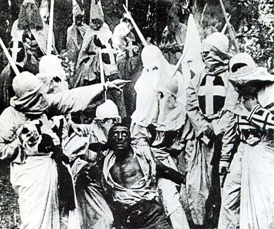 A still of the Klu Klux Klan killing a black man in the film