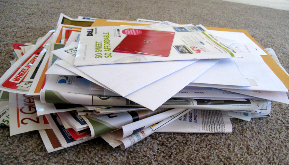 Pile of advertisements and coupons delivered by mail