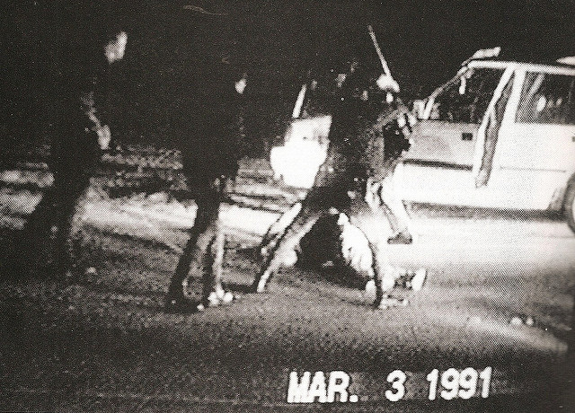 A screen shot of the video of the beating of Rodney King in Los Angeles in 1991. This later sparked many riots.