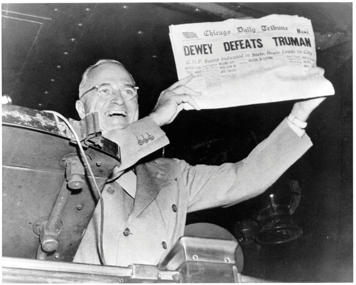 President Harry Truman  holding up the newspaper with the headline