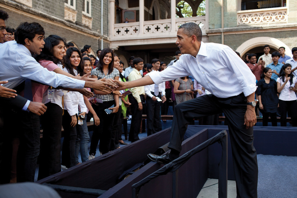 President Obama  shaking hands with a crowd