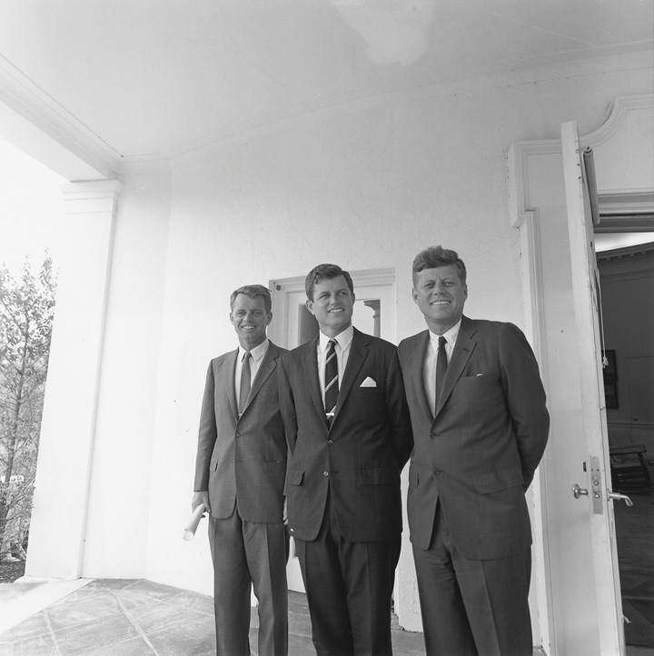 The Kennedy brothers standing side by side at the White House