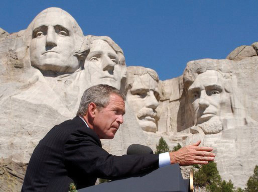 President George W. Bush speaking in front of Mt. Rushmore