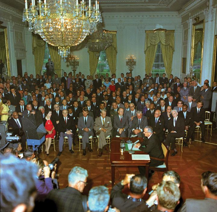 Lyndon B. Johnson signing the landmark Civil Rights Legislation