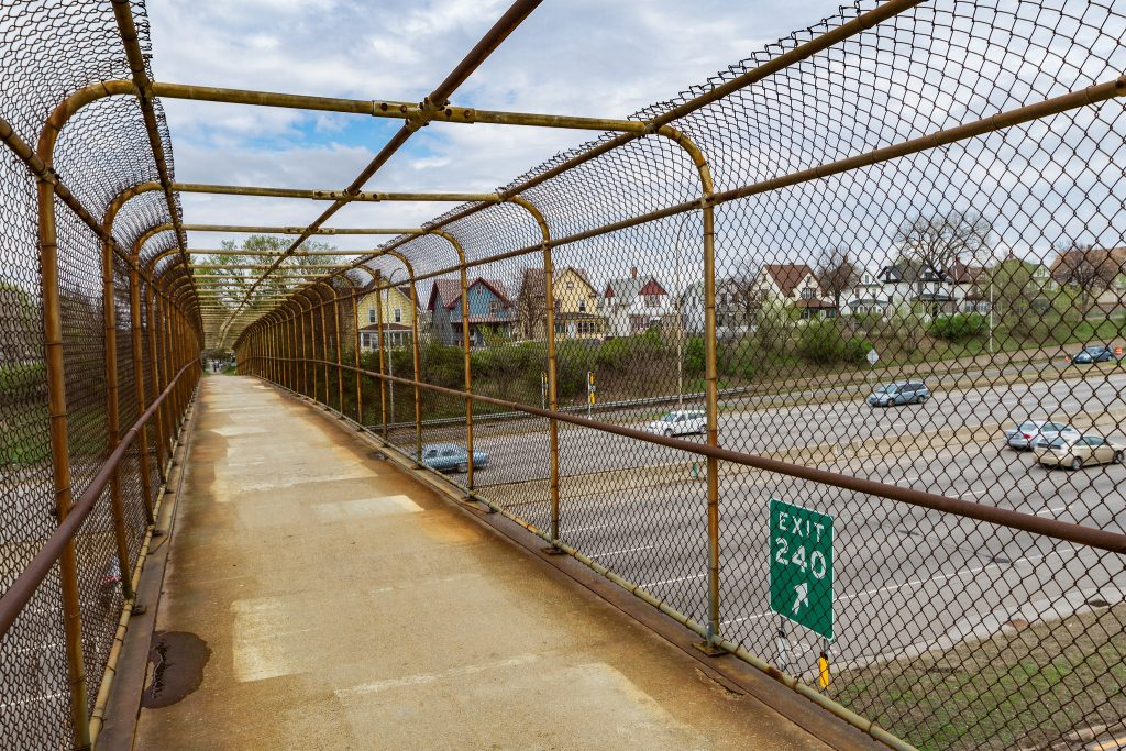 A pedestrian bridge between the divided Rondo neighborhood in St. Paul, MN. Once a thriving African American community, Rondo was split in two by the construction of Interstate Highway 94 in the 1970s. Today Rondo leaders are advocating for more substantial connections.