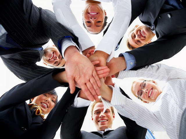 Hands in during a group huddle