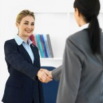 A salesperson and a customer shaking hands