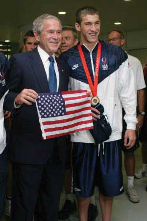 Micheal Phelps standing next to George Bush