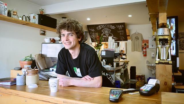 A happy barista behind a counter