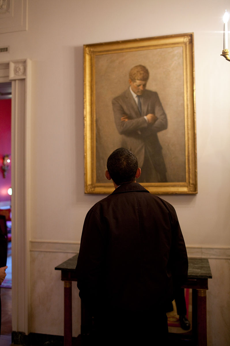 President Obama looking at a painting of President Kennedy in the White House