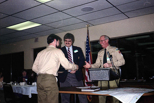 Scenic District Recognition Banquet 1985. Three men share greetings