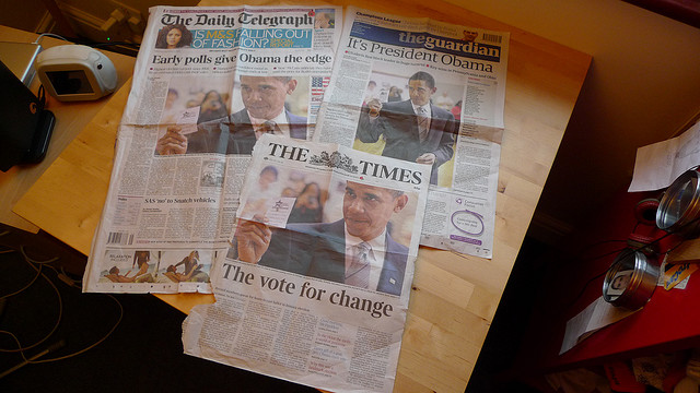 Three news papers on a table (The Daily Telegraph, The Guardian, and The Times), all predicting Obama has the edge in the early polls.