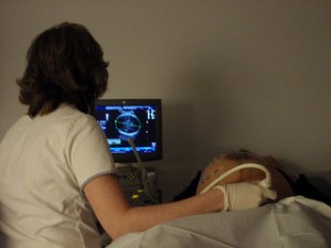 A woman giving a patient a sonogram