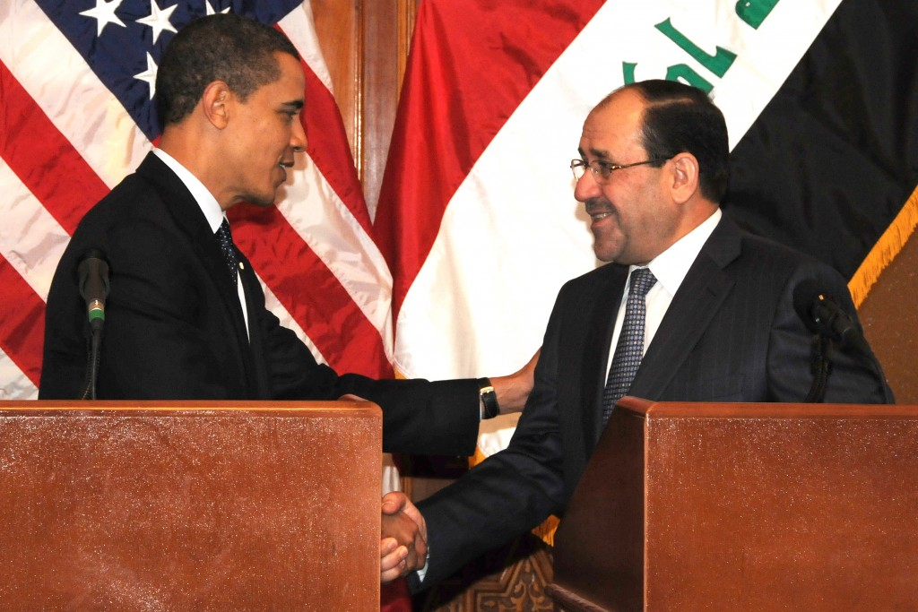 US President Barack Obama shakes hands with Prime Minister Nouri al-Maliki after a joint press event on Camp Victory, Iraq, April 7. (Photo by US Army Spc. Kimberly Millett, MNF-I Public Affairs)