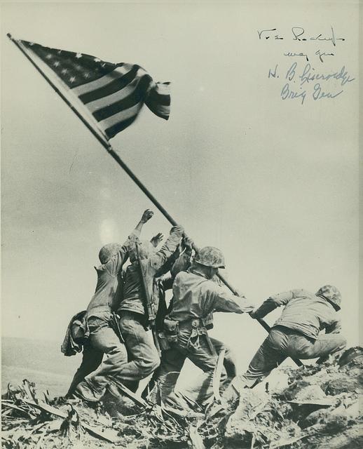 Historic photo of US troops raising the flag on Iwo Jima