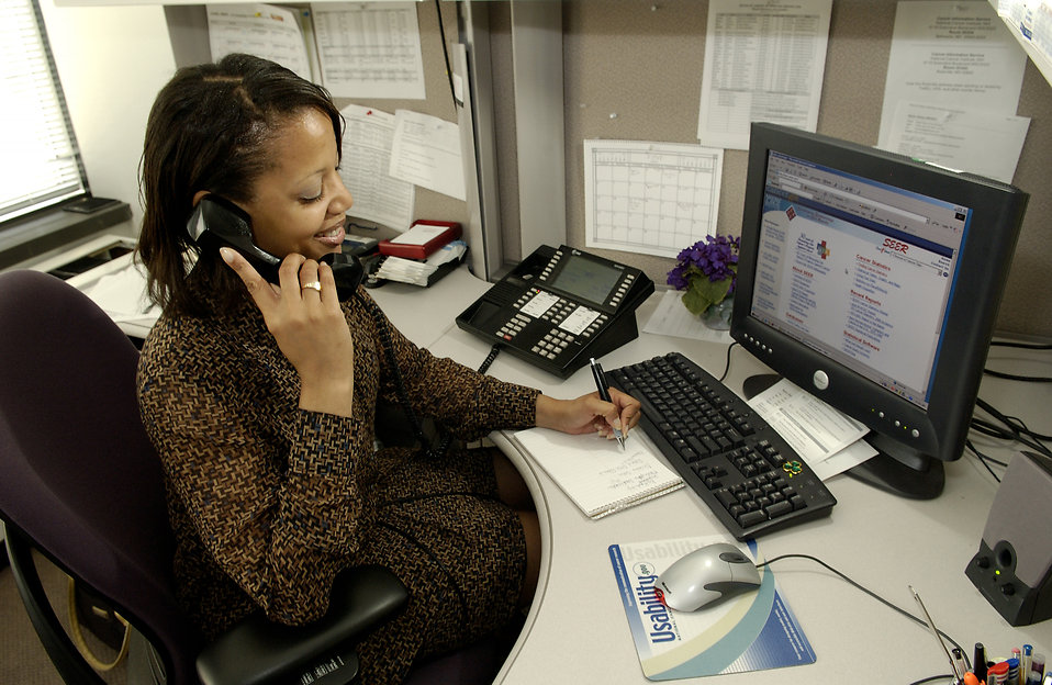 A business woman talking on the phone with a client