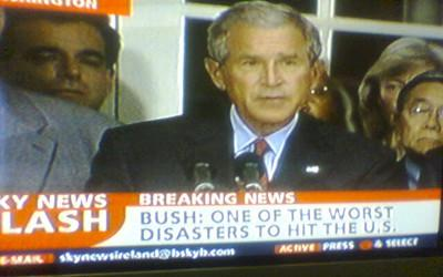 George Bush on the news with the headline