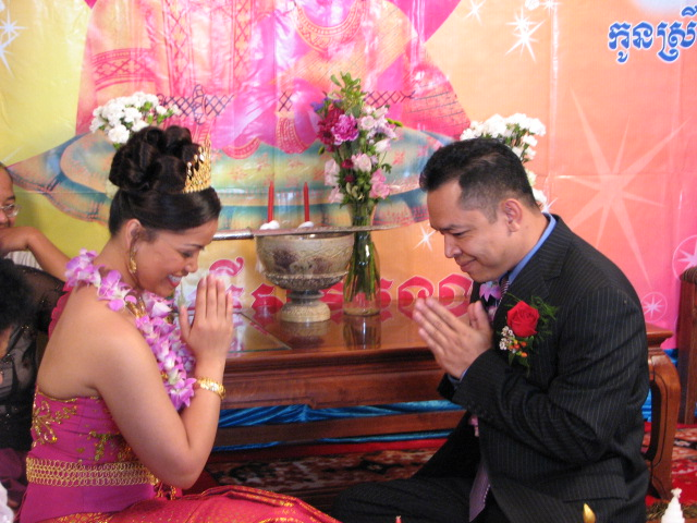 Communication varies across cultures, this show an asian couple bowing their heads at each other