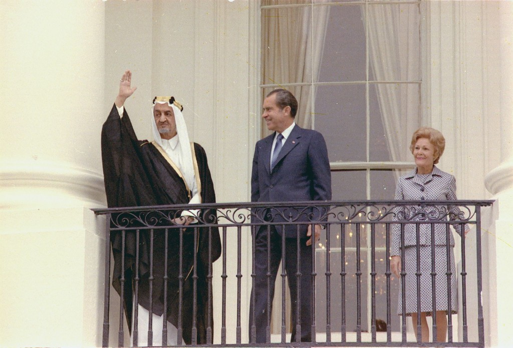 President Nixon and the first lady stand on a balcony during an arrival ceremony for King Faisal of Saudi Arabia