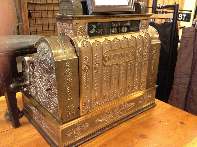 A very old, gold National Cash Register