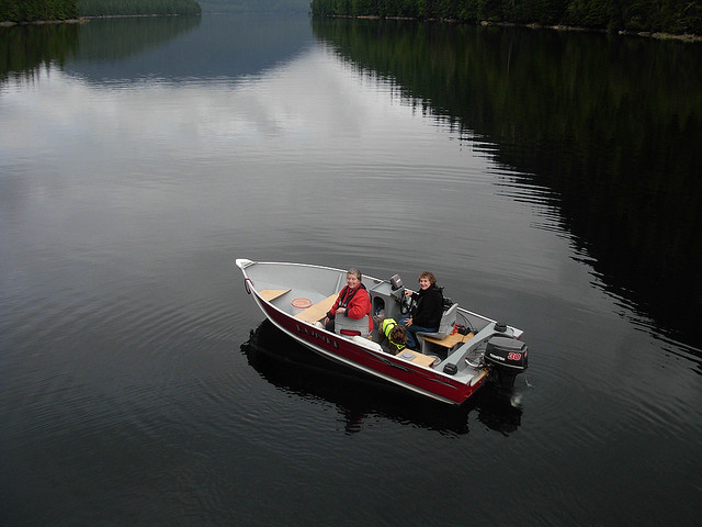 Two women sitting in a Lund boat in a big lake