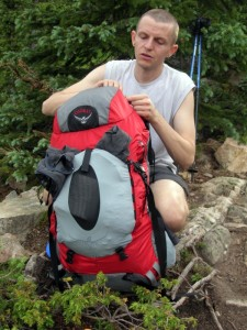 A man with an Osprey backpack