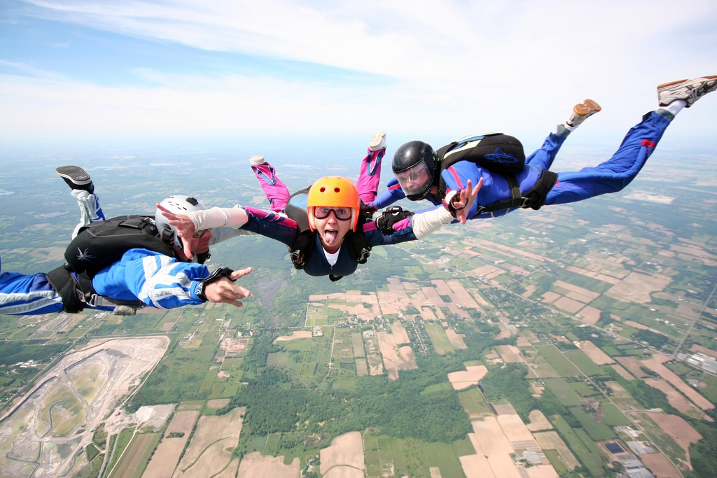 A woman skydiving with two instructors