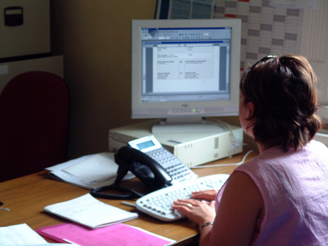 A woman using a desktop computer