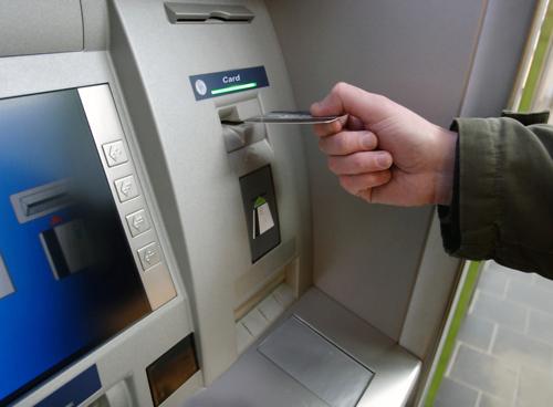A man using an ATM