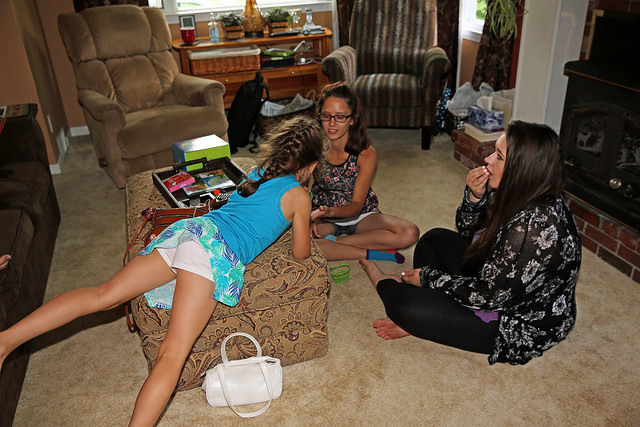 Three girl cousins playing a game together during a family visit